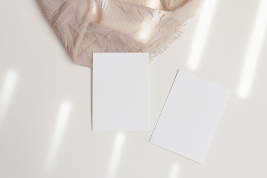 Two 5x7 card mockups on beige background