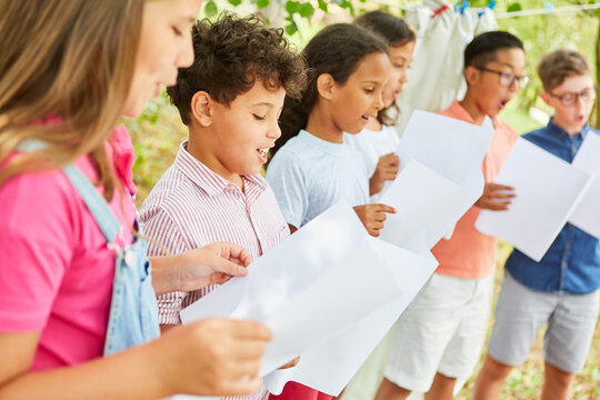 Children sing together in the choir at the summer camp