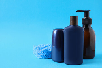 Wall Mural - Set of different men's cosmetic products on light blue background. Space for text