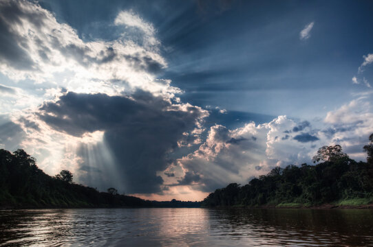 Dramatic light and clouds In the Amazon Basin of the Peruvian Rain forest located in the buffer zone to the Tambopata National Reserve.
