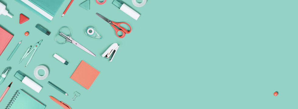 Assorted office and school white orange and green stationery supply on pastel trendy background as knolling. Copy space. Flat lay for back to school or education and craft concept.