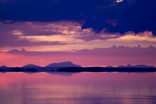 A sunset is reflected in the flood waters of the Salar de Uyuni in the department of Potosi in Bolivia.