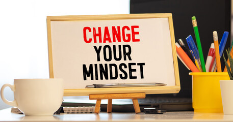 Change Your Mindset Text written on notebook page, red pencil on the right. Motivational Concept image