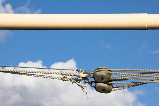 Pully with ropework against a blue summer sky