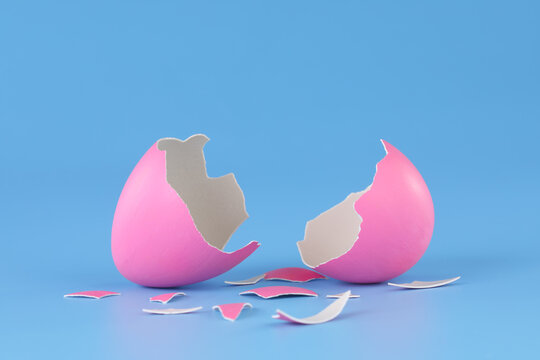 Pink Easter egg cracked open and broken into pieces.