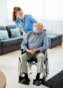 nurse doctor senior care caregiver help assistence wheelchair retirement home nursing mask virus corona