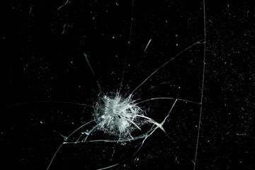 Obraz cracks on black glass background, broken abstract glass hole destruction concept - fototapety do salonu