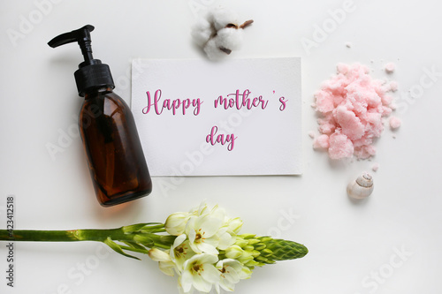 Mothers Day.Happy mother's day.Gift for mom with a note.Natural cosmetics for mom.A note with congratulations and cosmetics. Mom's skin care. Happy mother's day note.Postcard with cosmetics for mom
