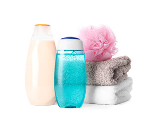 Wall Mural - Personal hygiene products with towels and shower puff on white background