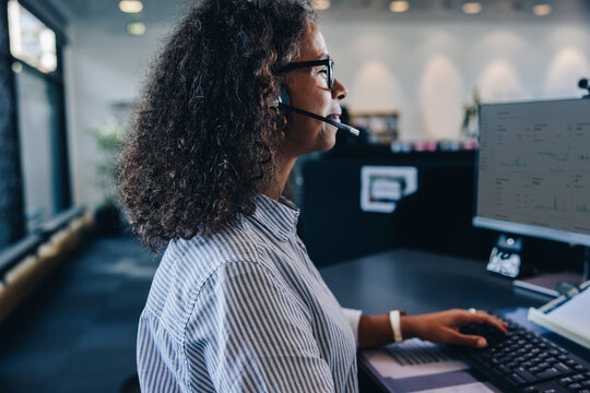 Female professional with headset at work