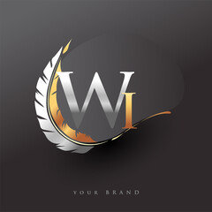 Fototapeta Initial letter WI logo with Feather Gold And Silver Color, Simple and Clean Design For Company Name. Vector Logo for Business and Company. obraz