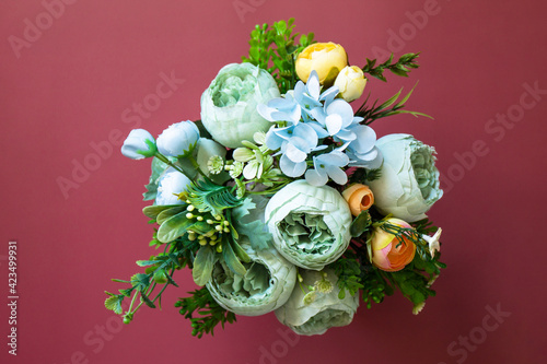 Mother's day or birthday greeting card concept. Festive flower arrangement, beautiful bouquet colorful flowers in vase. Top view flat lay.