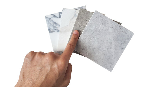 hand choosing to tile samples collection isolated on white background with clipping path. luxury marble and stone ceramic tile use as interior material for flooring ,counter top ,back splash works.