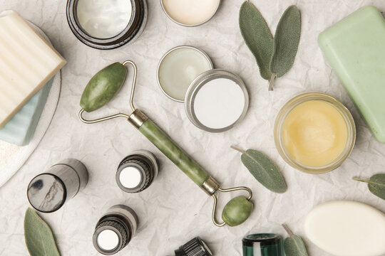 Natural organic skin care product. Home spa and self care product top view. Facial serums, essintials oils, creams, jade roller and soap bars with copy space.