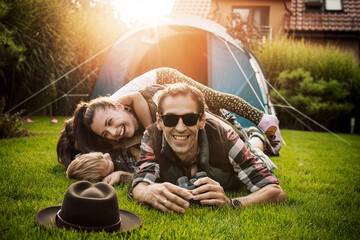 Cheerful family realxing on a camp