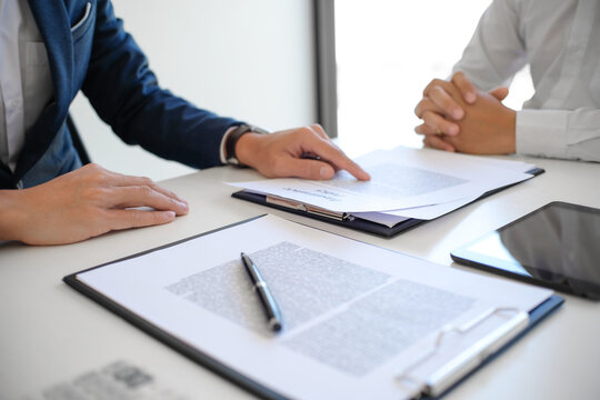 Sales manager giving advice application form document, considering mortgage loan offer for car and house insurance. Real estate investment Property insurance and security. Real estate agent offer