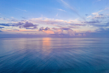 Relaxing seascape with wide horizon of the sky and the sea. Sunset over the sea, tranquil nature view, aerial ocean panorama. Colorful clouds, sunrise sunset dream natural environment, Earth concept