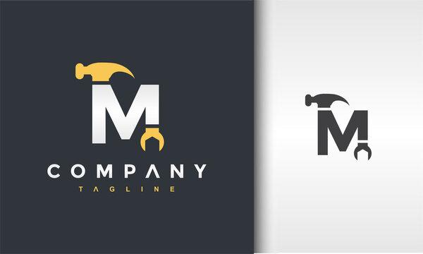 letter M hammer wrench logo
