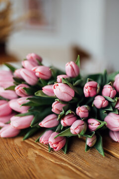 bouquet of tulips on wood table. Border design