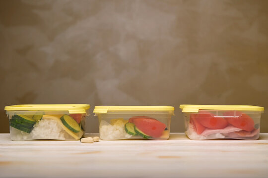 three containers with a fresh healthy food on table