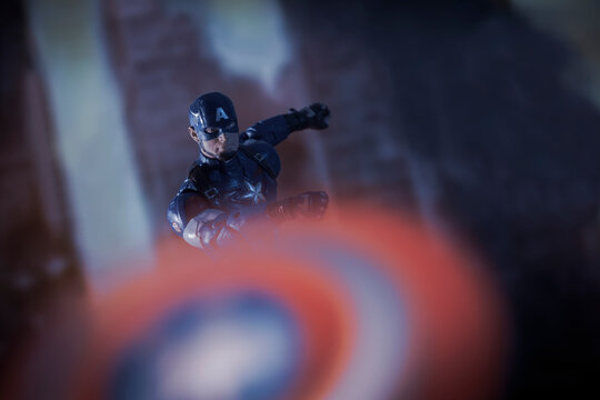 NEW YORK USA - APRIL 8 2021:  Scene from Marvel's The Avengers - Captain America in action throwing his shield - Hasbro action figure