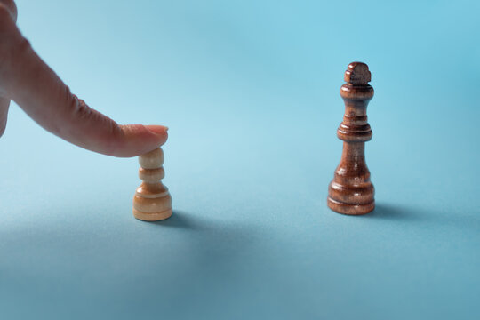 Career ambitions, concept, novice vs specialist, pawn vs queen. Chess pieces