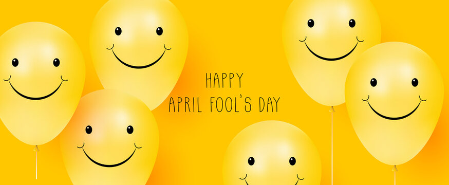 Happy April Fool's day. Yellow background with smiling balloons. Positive emotions