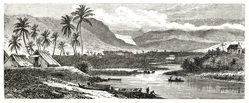 Large tropical landscape horizontal arranged with palms, huts and river in the center. saint-Gilles, Reunion island. Ancient grey tone etching style art by De Berard, Le Tour du Monde, 1862
