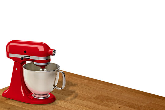 Red Stand, countertop or kitchen Mixer on empty perspective view wooden table or countertop isolated on white background including clipping path.