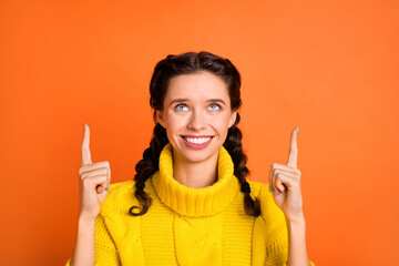 Portrait of charming cheerful person look direct fingers up empty space promotion isolated on...