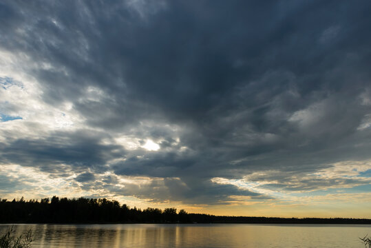 Sunset sky with rain cloud on the lake.