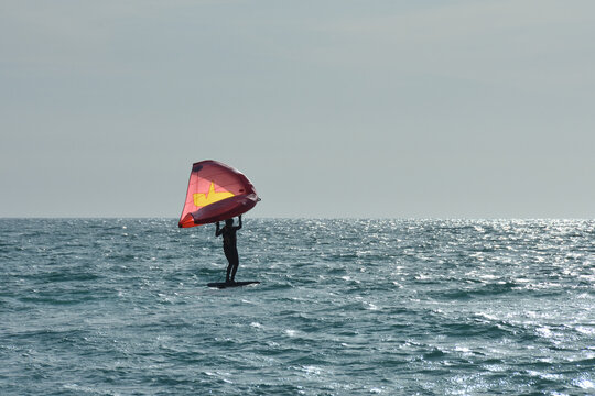 A windsurfer surfing the waves at Lido Key, Sarasota, Florida, USA.