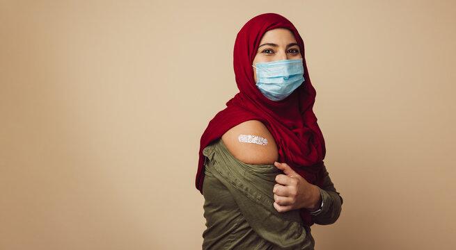 Muslim woman in hijab received a vaccine