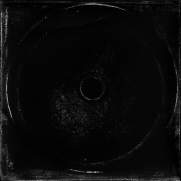cd mark texture on paper for old cover art. grungy frame in black background. can be used to replicate the aged and worn look for your creative design.