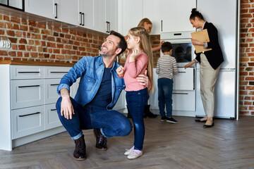 Fototapeta Big family checking their future house