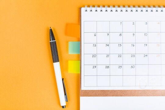 closing month calendar for 2021 on orange background, planning a business meeting or travel planning concept