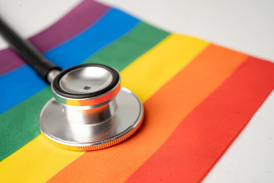 Black stethoscope on rainbow flag background, symbol of LGBT pride month celebrate annual in June social, symbol of gay, lesbian, bisexual, transgender, human rights and peace.