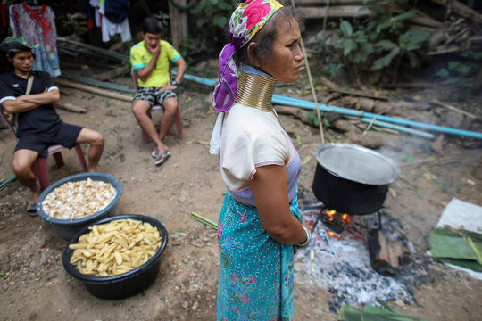 A long neck woman attends a death anniversary in the Kayan village where people, who fled from Myanmar during the 1990s war between Myanmar's army and ethnic army groups, live in Mae Hong Son