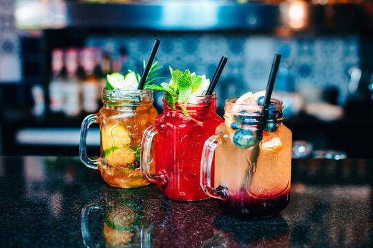 Colorful vodka cocktails serve in Mason Jars. Delicious drinks.