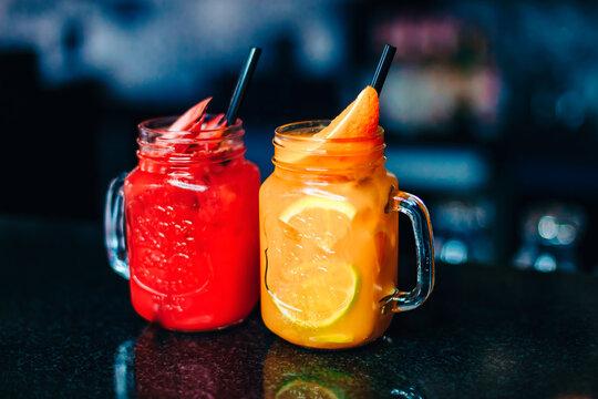 Colorful vodka cocktails serve in Mason Jars. Delicious drinks. Copy space.