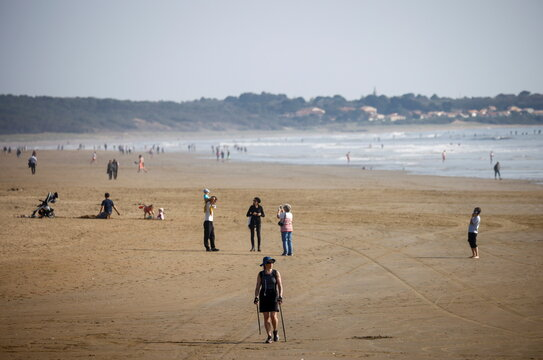 People enjoy a sunny and warm weather on the beach in Saint-Brevin-Les-Pins