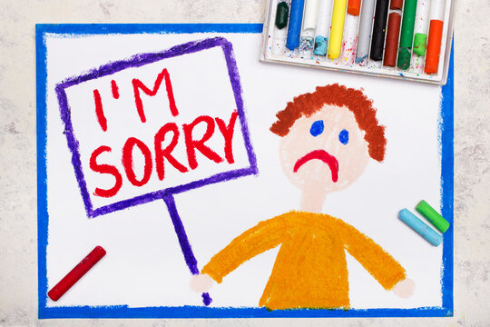 Colorful drawing: Sad man holding a sign with word: I'm sorry