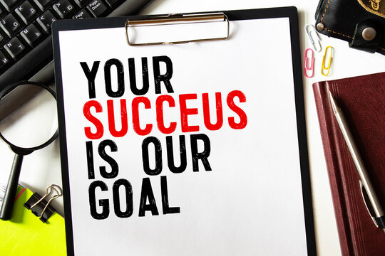 Text your success is our goal on the short note texture background