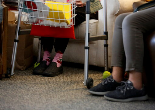 Sakaguchi, 94, wears cherry socks as she sits with her daughter Sakaguchi at Nikkei Manor, an assisted living facility in Seattle