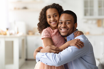 Fototapeta Loving black family father and daughter hugging obraz