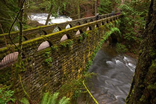 Historic Whatcom Falls Bridge Washington State. Whatcom Creek and the historic stone bridge crossing it. Bellingham, Washington.