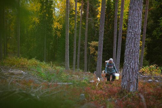 Senior woman in autumn forest