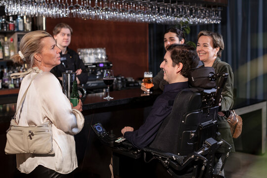 Group of friends having drinks in bar