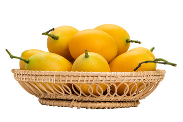 Fototapete - Closeup of ripe Marian Plum in bamboo basket on white background with clipping path. Delicious sweet yellow marian plum in Thailand.