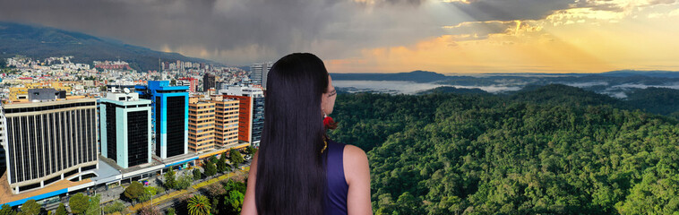 Fototapeta An indigenous person looking at the changing landscape going from tropical forest towards a cityscape with skyscrapers obraz